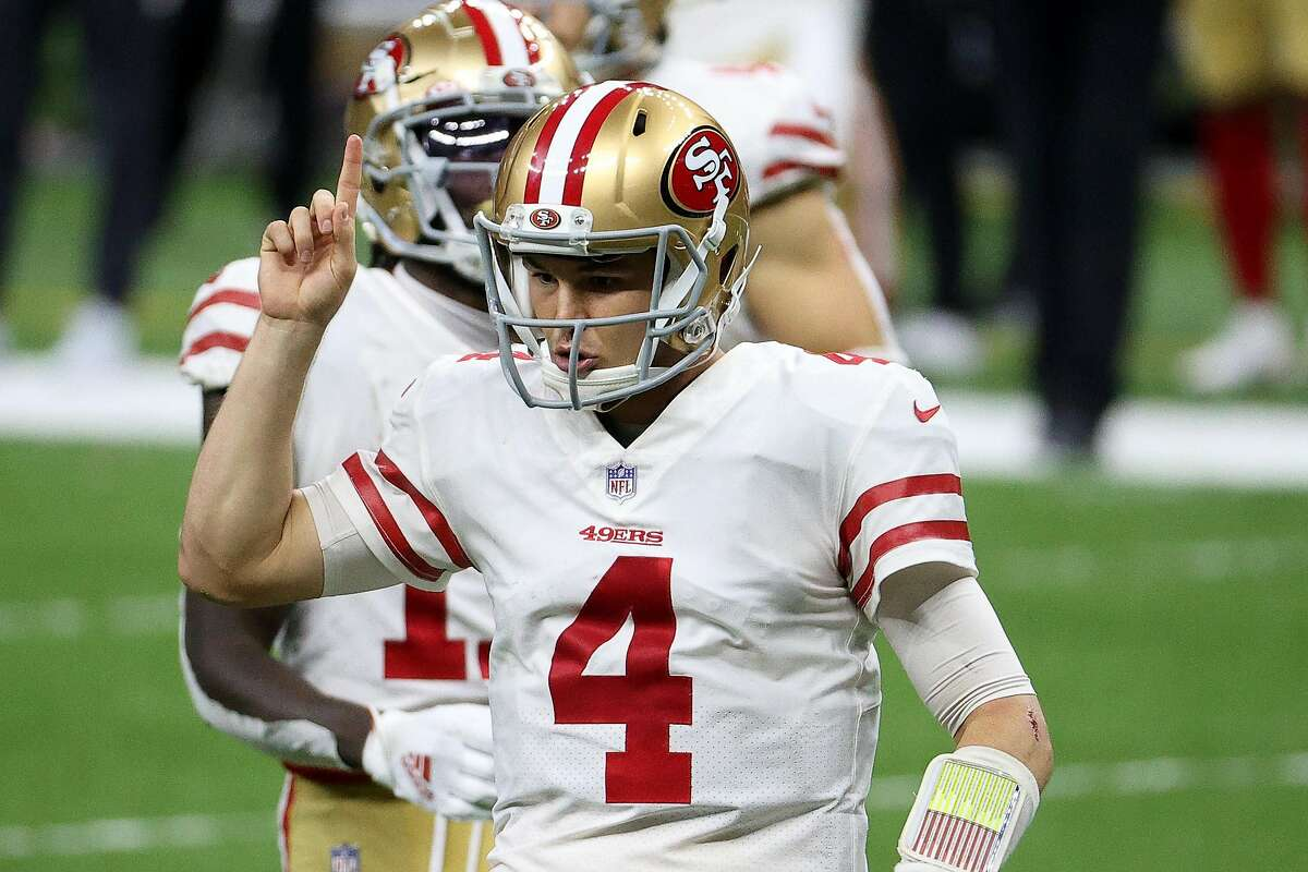 NEW ORLEANS, LOUISIANA - NOVEMBER 15: Nick Mullens #4 of the San Francisco 49ers reacts following a play during their game against the New Orleans Saints at Mercedes-Benz Superdome on November 15, 2020 in New Orleans, Louisiana. (Photo by Chris Graythen/Getty Images)