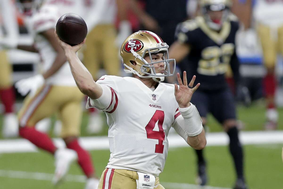 San Francisco 49ers quarterback Nick Mullens (4) passes in the first half of an NFL football game against the New Orleans Saints in New Orleans, Sunday, Nov. 15, 2020. (AP Photo/Brett Duke)