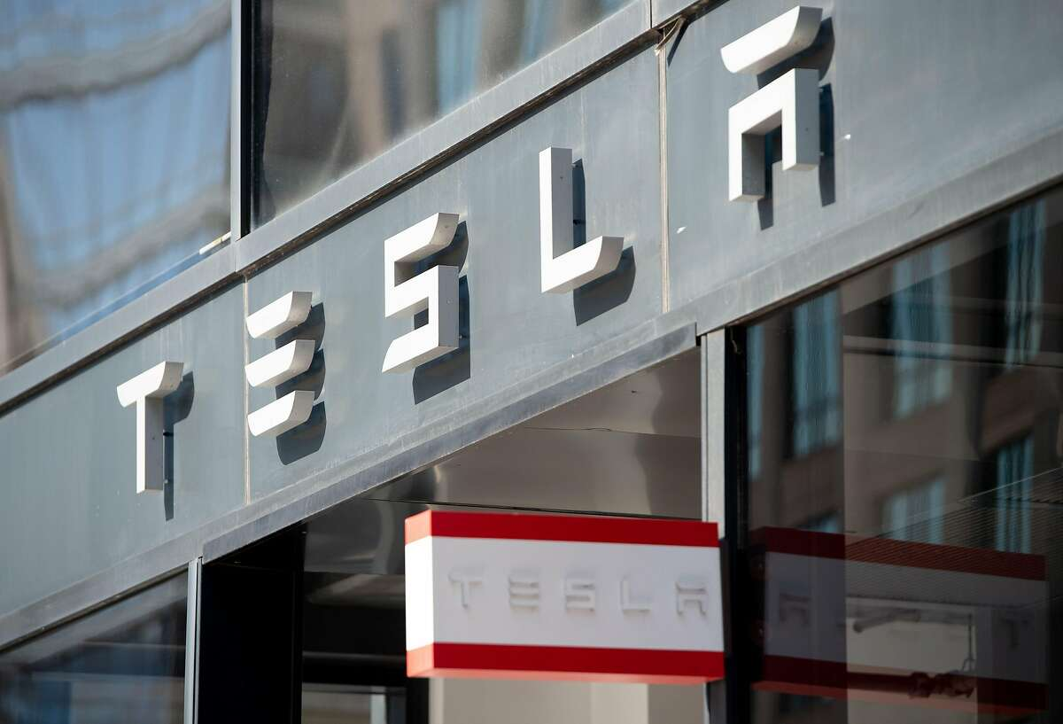 In this file photo taken on August 8, 2018 The Tesla logo is seen outside of their showroom in Washington, DC. The Fremont Police Department is planning to expand its fleet of all-electric-powered patrol vehicles after its Tesla Model S 85 scored high marks in what was among the first pilot programs of its kind in the country.