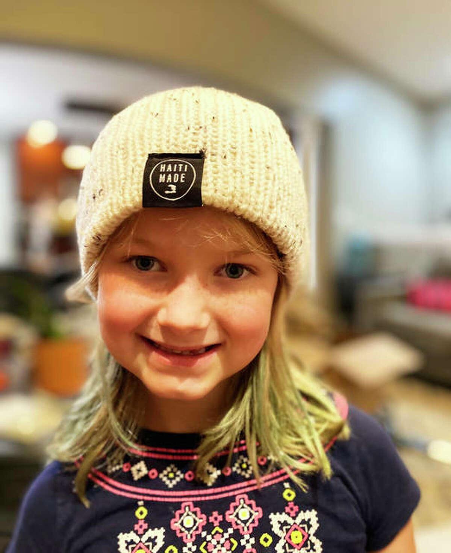 Brooklyn Runyon, 7, models a hand-knit cap from Haiti Made.
