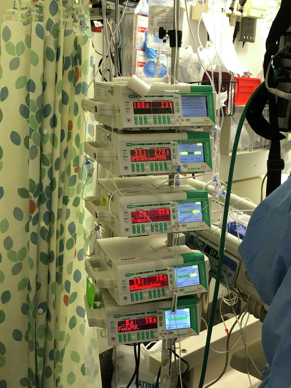 Seven IV infusion pumps attached to a single patient with severe complications from COVID-19 at North Central Bronx Hospital in New York City.