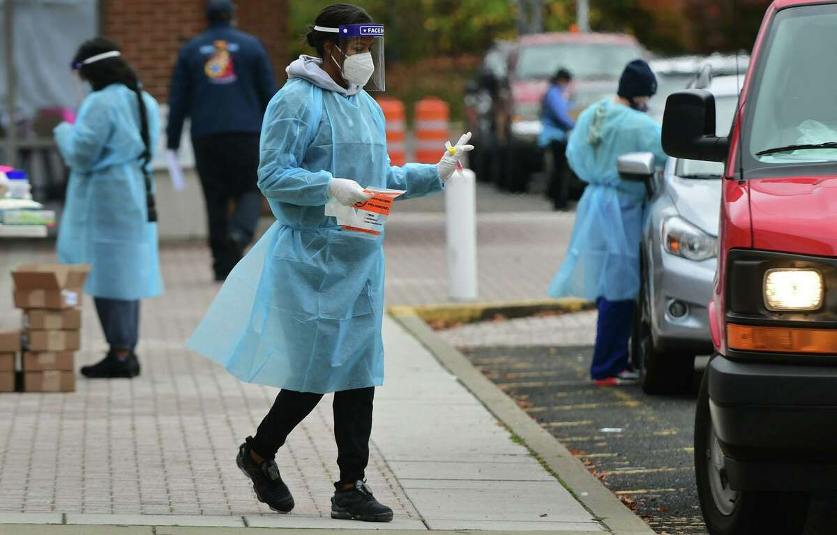 Day Street Community Health Center staff conduct drive-thru coronavirus testing on Oct. 28, at Brien McMahon High School in Norwalk.