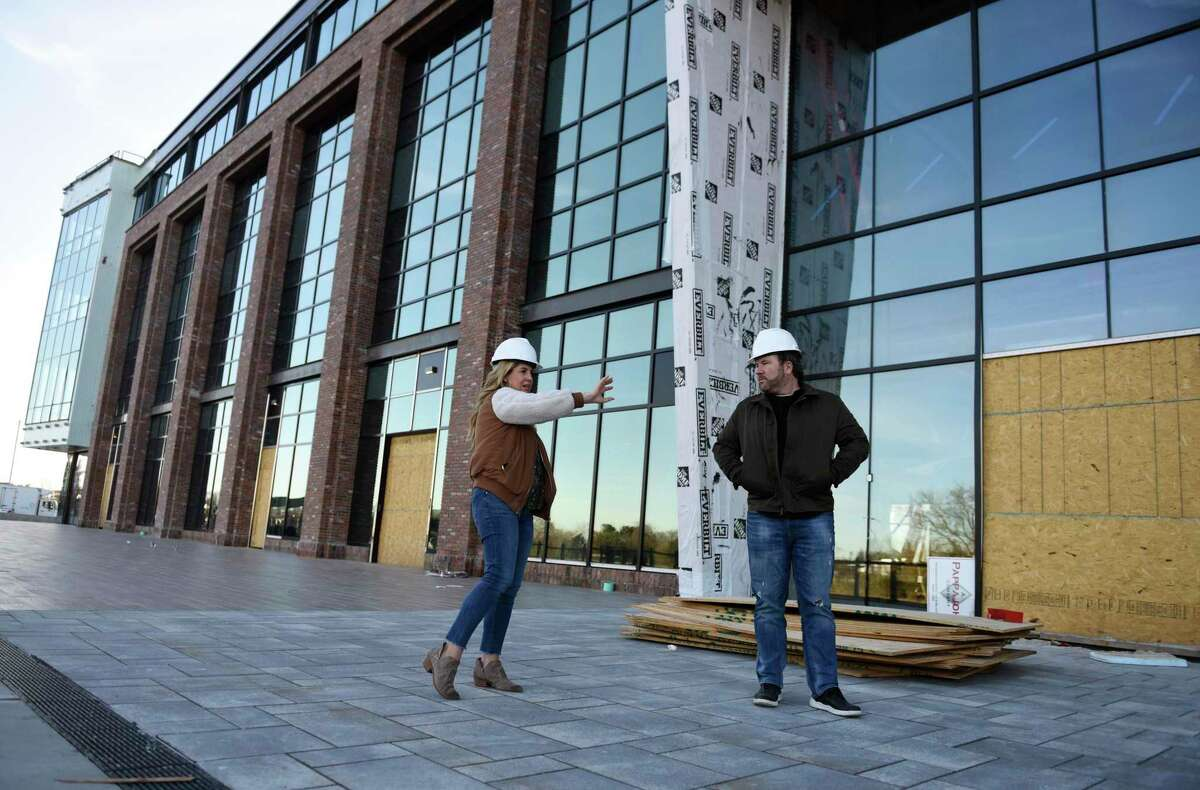 Wheelhouse Properties head Courtney Montgomery and Wheelhouse CEO Brent Montgomery lead a tour of The Village center in Stamford, Conn., on Tuesday, Nov. 24, 2020. Located at 860 Canal St., the 133,000-square-foot facility is set to open in the spring of 2021.
