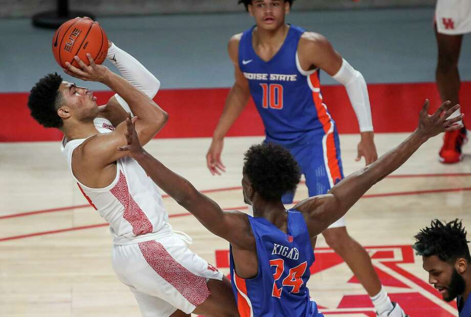 Houston Cougars guard Quentin Grimes (24) shoots over Boise State Broncos forward Abu Kigab (24) during the first half of an NCAA basketball game Friday, Nov. 27, 2020, at the Fertitta Center in Houston. Photo: Jon Shapley, Staff Photographer / © 2020 Houston Chronicle