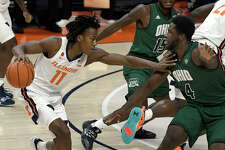 Illinois' Ayo Dosunmu (11) pushes past Ohio's forward Dwight Wilson III (4) during the first half of an NCAA college basketball game Friday, Nov. 27, 2020, in Champaign, Ill.