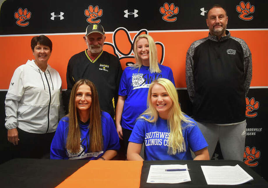 Edwardsville senior Taylor Hope, seated right, will play college softball for Southwestern Illinois College in Belleville. She is joined by her family, college coach, club coach and EHS coach Lori Blade. Photo: Matt Kamp|The Intelligencer