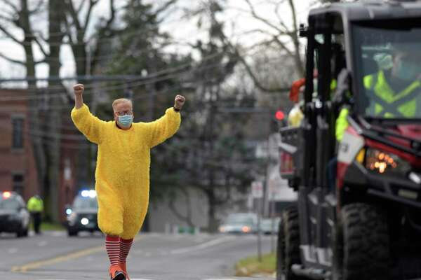 Mayor Mark Boughton, dressed as a chicken, and Taylor O'Brien, the city's public relations coordinator, dressed as a unicorn, are competing to raise the most money for Danbury area food banks. The looser was suppose to dress up in a costume and run from city hall to the library but they both decided to make the run. Friday, November 27, 2020, in Danbury, Conn.