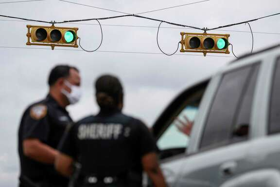 Harris County Sheriff's deputies speak to a woman after Dussette initiated a traffic stop Wednesday, June 24, 2020, at the intersection of Bellaire Boulevard and Metro Boulevard in Houston.