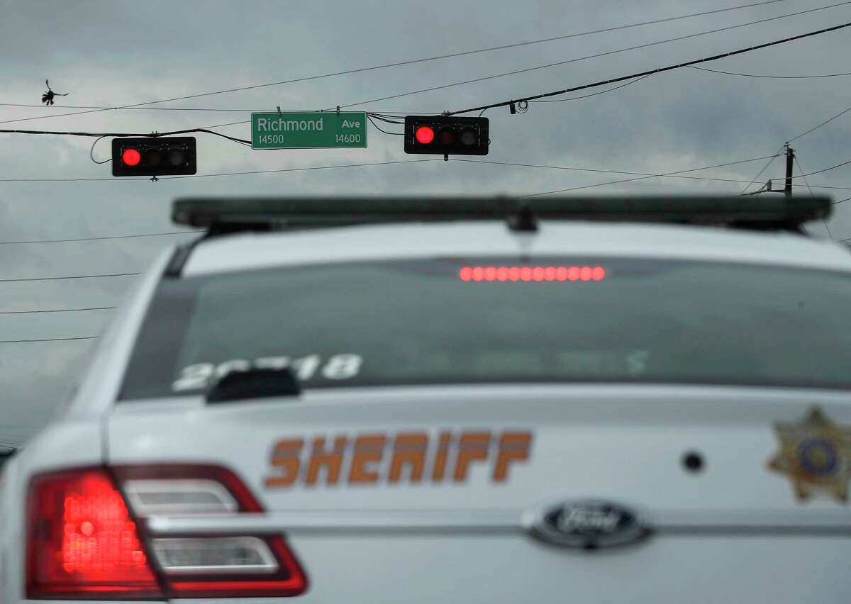 Harris County Sheriff's Deputy waits at a red light on June 24, 2020, at the intersection Richmond Avenue and State Highway 6 in Houston.