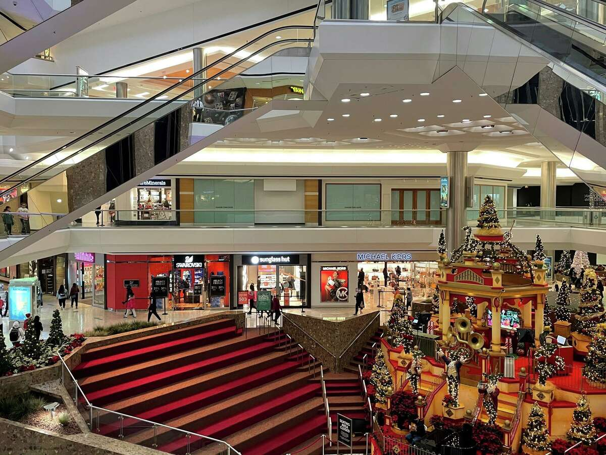 Shoppers frequent stores at Stamford Town Center mall on Friday, Nov. 27, 2020.