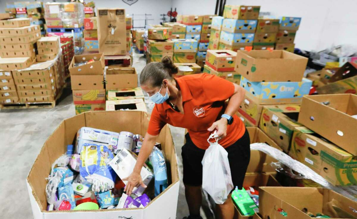 Volunteer Suzanne Hollifield sorts through child items at Saint Isidore Episcopal Church's event space, Thursday, July 16, 2020, in Spring. The non-profit recently began utilizing its kitchen and food pantry to help the community amid the coronavirus pandemic after renovating the 8,000 square-foot building.