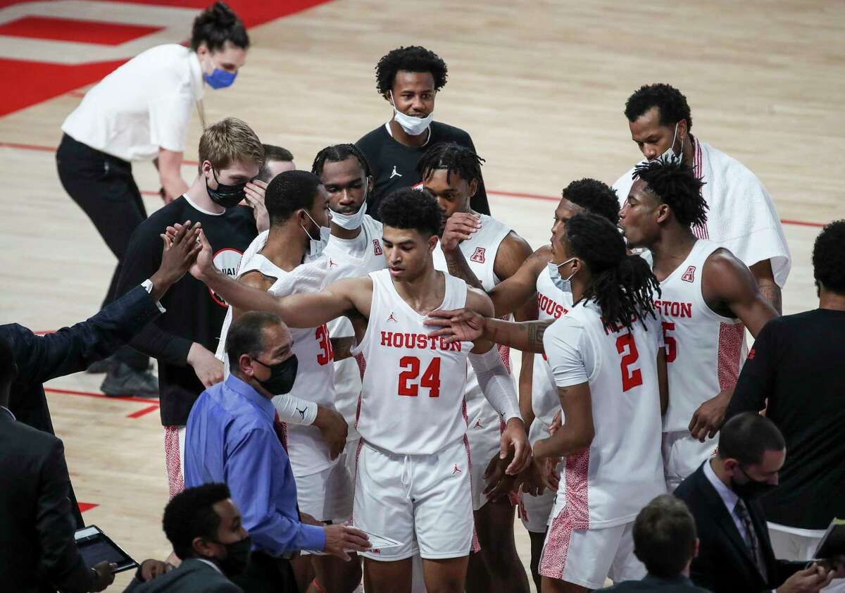 Houston Cougars guard Quentin Grimes (24) is congratulated by teammates after a making 3-point shot during the first half of an NCAA basketball game Friday, Nov. 27, 2020, at the Fertitta Center in Houston.