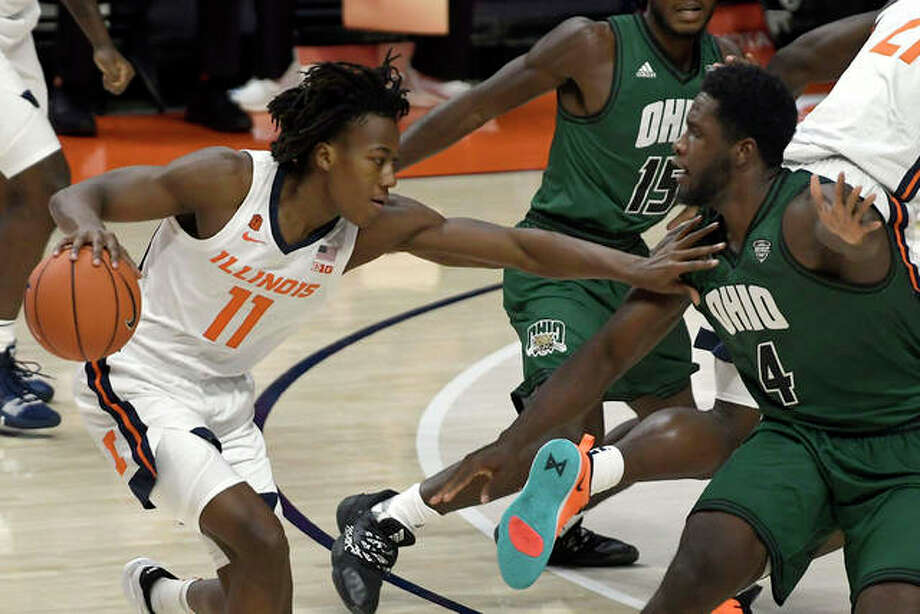 Illinois' Ayo Dosunmu (11) fends off Ohio's Dwight Wilson III (4) in Friday's game in Champaign.' Photo: Associated Press
