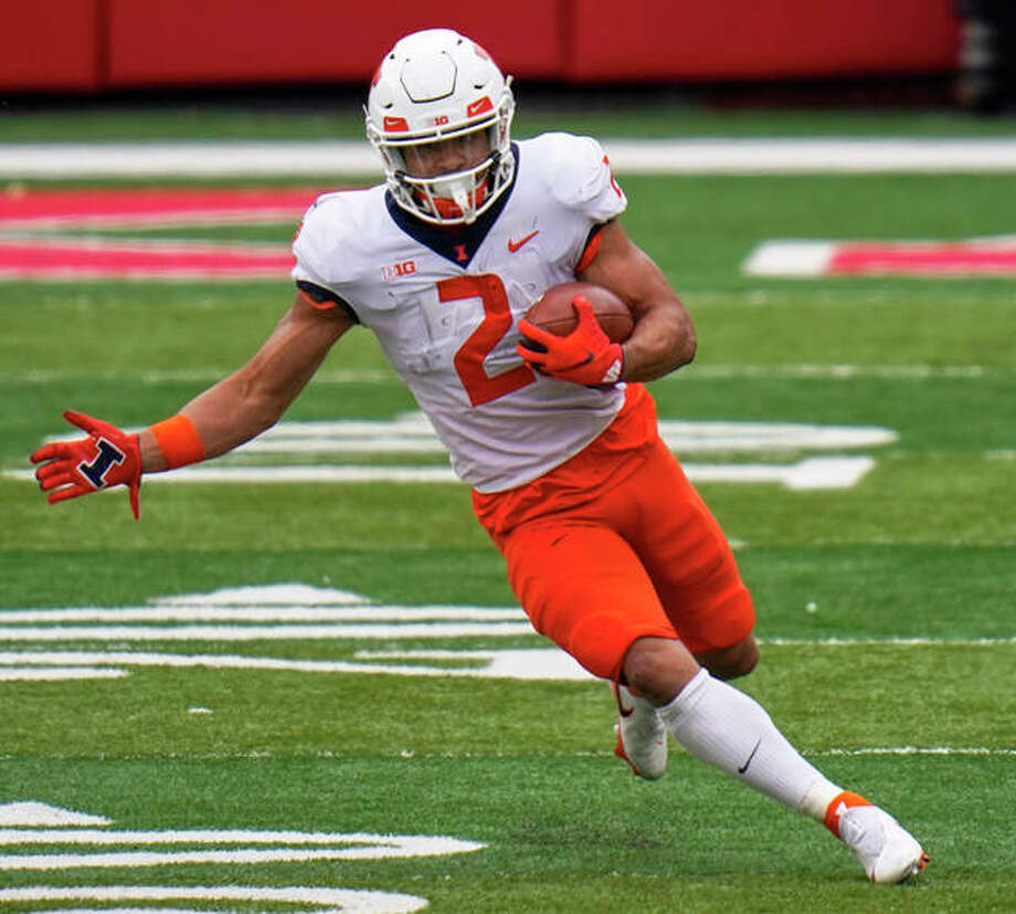 Illinois running back Chase Brown runs against Nebraska during the first half of the Illini's victory last Saturday in Lincoln, Neb. Photo: Associated Press