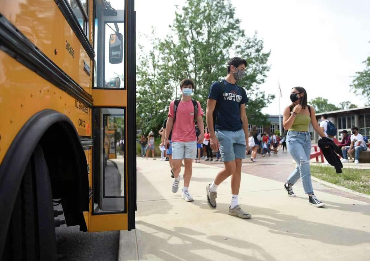 Students at Greenwich High School leave school on Wednesday, Sept. 9, 2020.