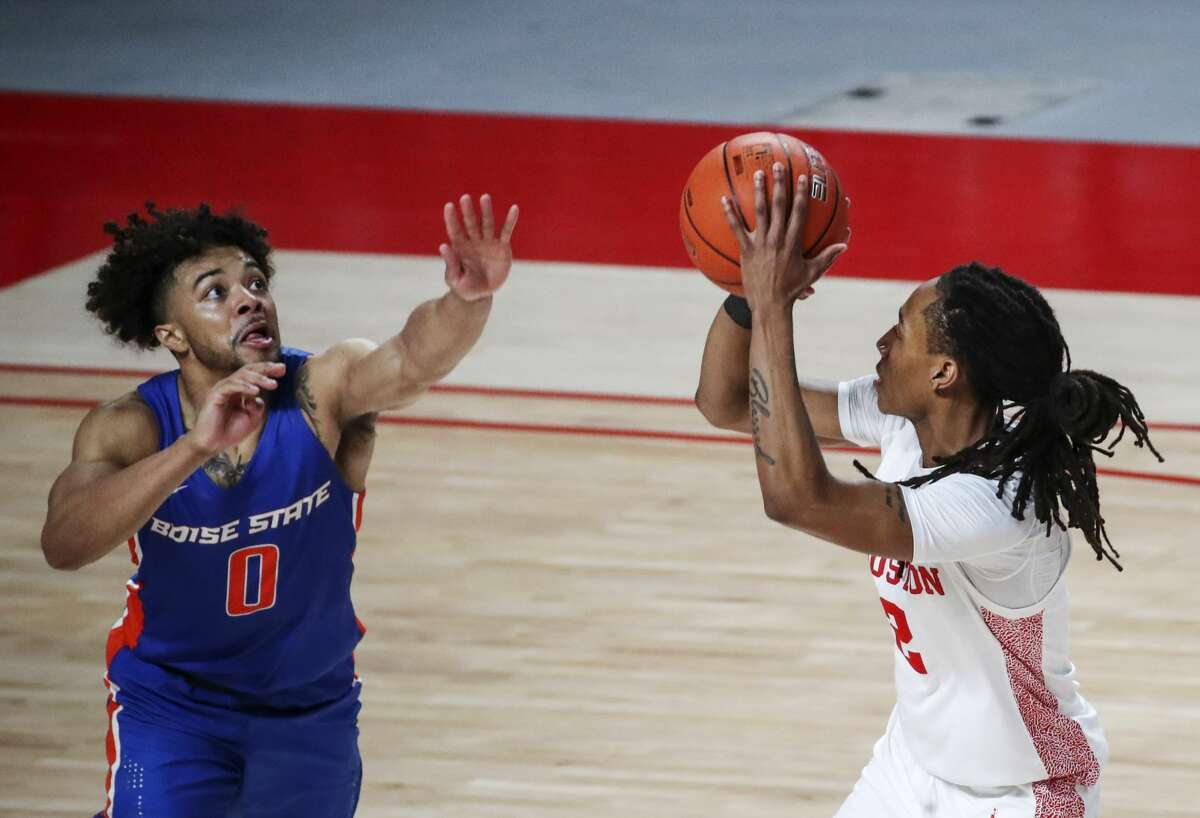 Boise State Broncos guard Marcus Shaver Jr. (0) defends Houston Cougars guard Caleb Mills (2) during the second half of an NCAA basketball game Friday, Nov. 27, 2020, at the Fertitta Center in Houston.