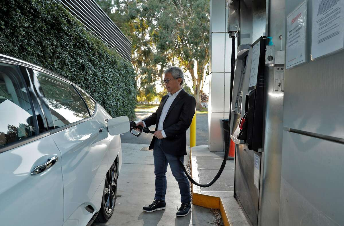 Tadashi Ogitsu refuels his hydrogen fuel cell Honda Clarity near his home in San Ramon, Calif., on Wednesday, November 25, 2020. California's push to phase out gas-powered cars has often focused on the future of battery-electric models. But a rival technology still in its infancy, hydrogen fuel-cell electric cars, could be a key part of the solution. California has until 2035 to meet Gov. Gavin Newsom?s order to end the sale of gas cars. According to a report from the state Air Resources Board, the charging infrastructure for fuel-cell cars could become self-sufficient in about a decade. Ogitsu has driven a hydrogen fuel-cell vehicle since 2017. He said he chose a hydrogen model over a battery-electric car because it can refuel quickly and has a longer range, so he can make weekend road trips to Yosemite with ease.
