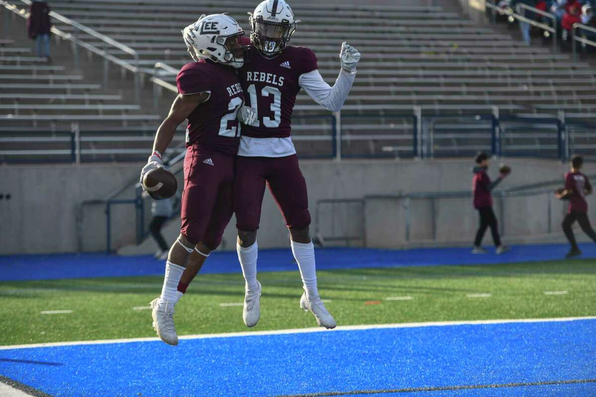 Lee's Makhilyn Young and Shemar Davis (13) celebrate after Young scored a touchdown Friday, Nov. 27, 2020 at Grande Communications Stadium. Jacy Lewis/Reporter-Telegram