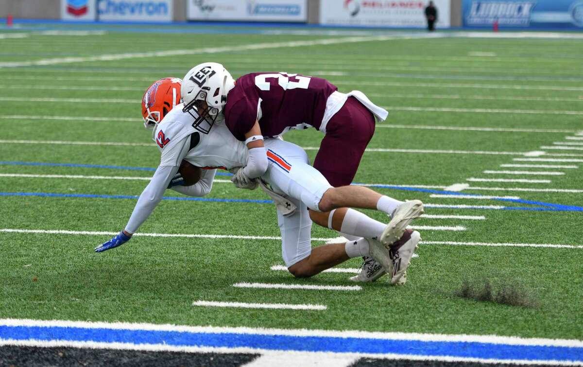 Lee's Finley Higgins (24) tackles San Angelo Central's Tyler Hill (12) on Friday, Nov. 27, 2020 at Grande Communications Stadium. Jacy Lewis/Reporter-Telegram