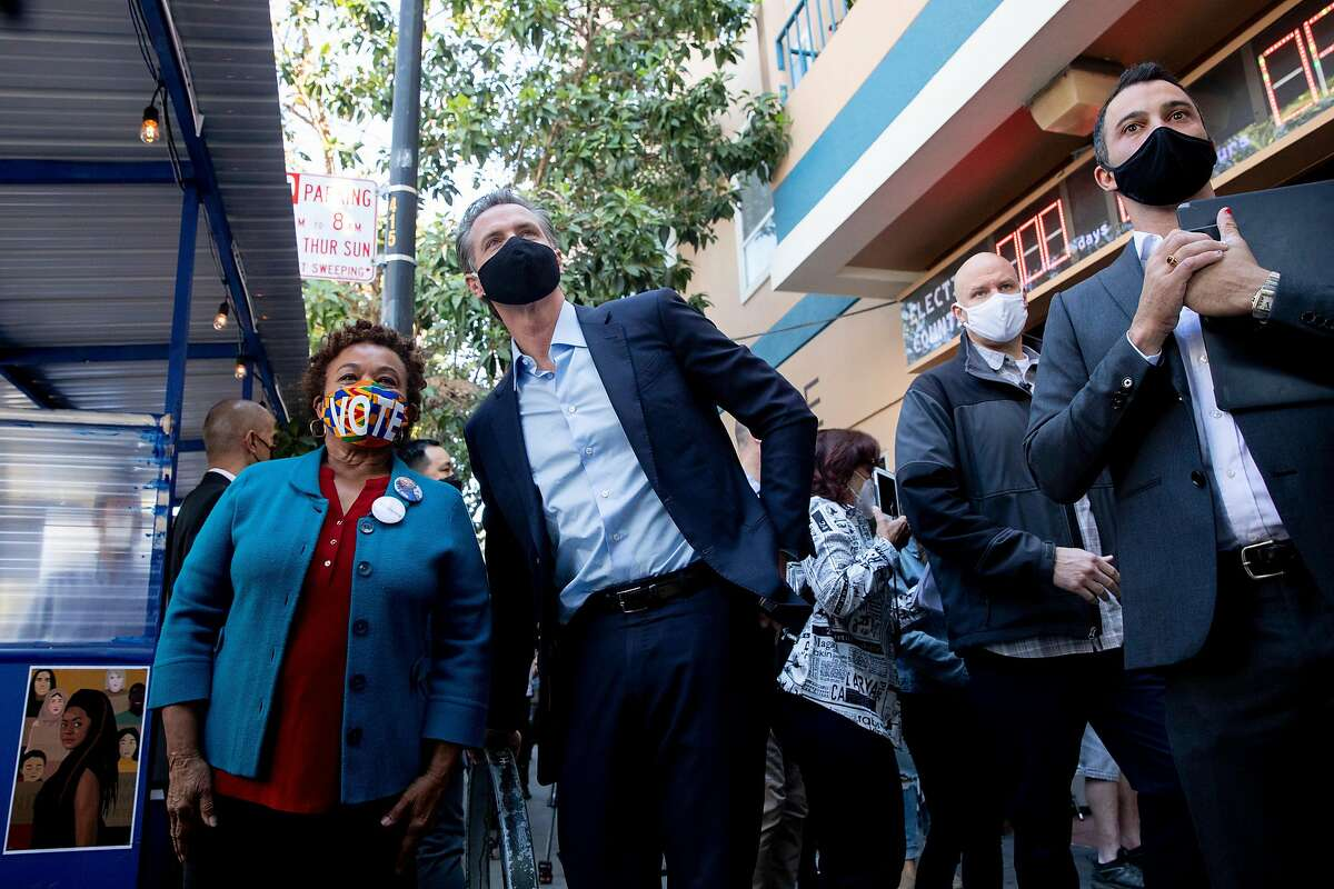 California Governor Gavin Newsom poses for a picture with Congresswoman Barbara Lee after phone and text banking for democratic candidates while outside of Manny's cafe and communal space in San Francisco, Calif. Tuesday, November 3, 2020. California elected officials gathered to phone bank for Joe Biden and Kamala Harris as well as other democratic candidates in battleground states.