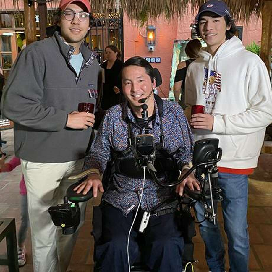 Dr. Rex Marco (middle) after being paralyzed due to a neck injury at Memorial Park