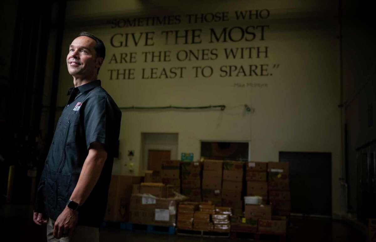 San Antonio Food Bank chief executive Eric Cooper's organization now is serving 120,000 people each week.