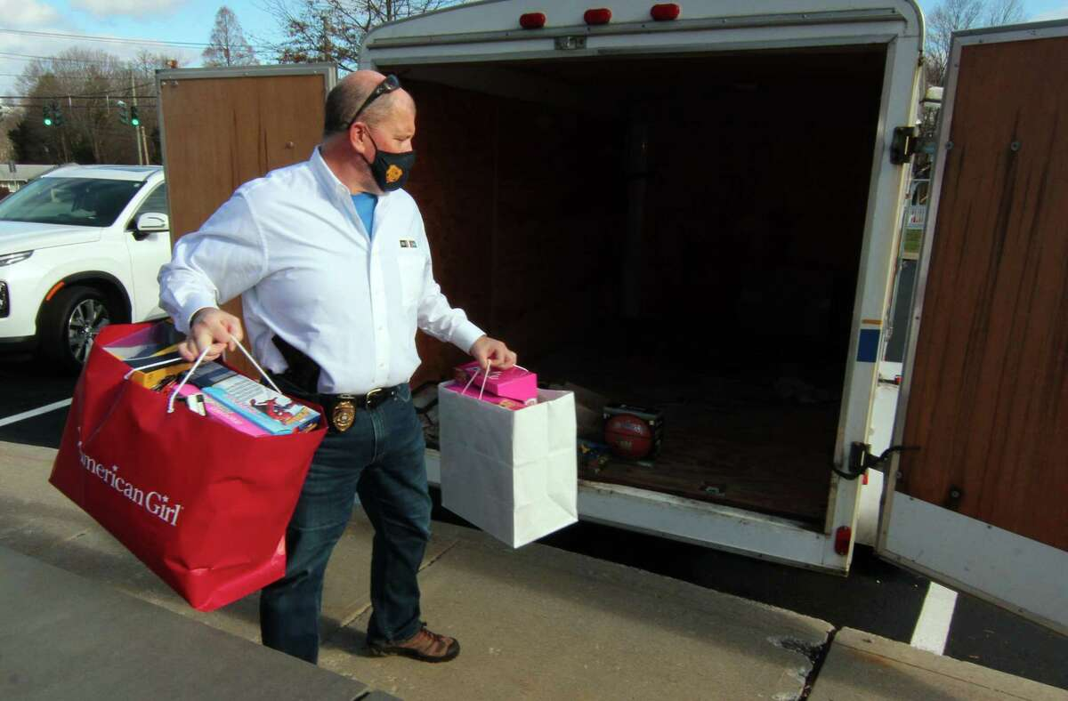 Clinton Police Department's Chief Vincent DeMaio places bags of donated gifts into its trailer at police headquarters in Clinton, Conn. Outside of emergency funds, business and community funds were the fastest-growing fundraising categories on GoFundMe. Meanwhile, one in three donors donated more than once this year, and 70 percent of donations were under $50.