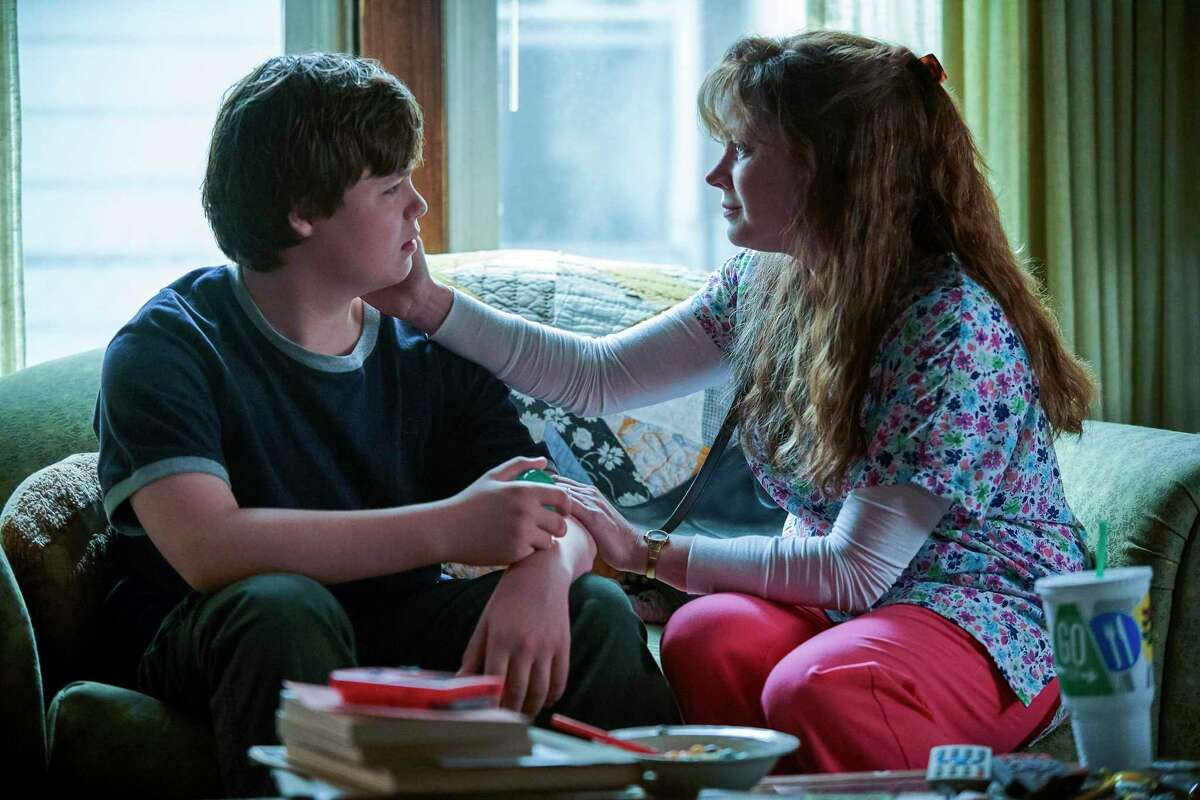 """This image released by Netflix shows Owen Asztalos, left, and Amy Adams in a scene from """"Hillbilly Elegy."""""""