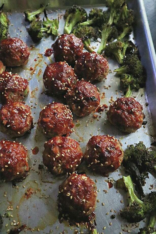 A sheetpan dinner of meatballs and broccoli comes together in short time, with no mess. (Gretchen McKay/TNS) / Pittsburgh Post-Gazette