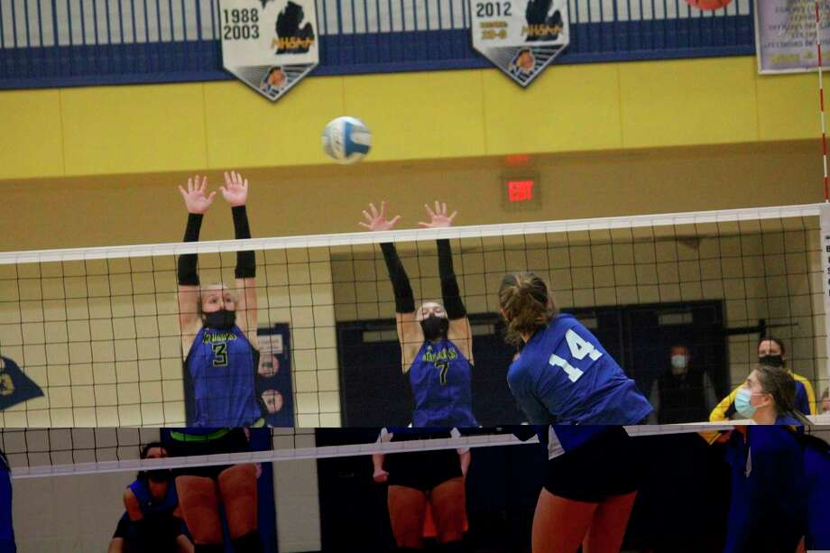 Morley Stanwood's Madison Garbow (3) and Ayiana Sims go up for the block during volleyball action this past season. (Pioneer photo/John Raffel)