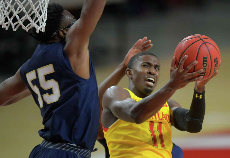 Maryland's Darryl Morsell gets to the basket against Navy's Richard Njoku during Friday's game at Xfinity Center. Photo: Washington Post Photo By John McDonnell / The Washington Post