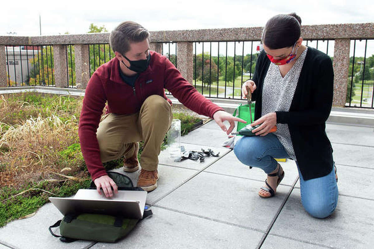 Environmental sciences graduate student Josh Gifford, left, and STEM Center research assistant professor, Dr. Carol Colaninno, retrieve the data from a noise monitor located on SIUE's campus.