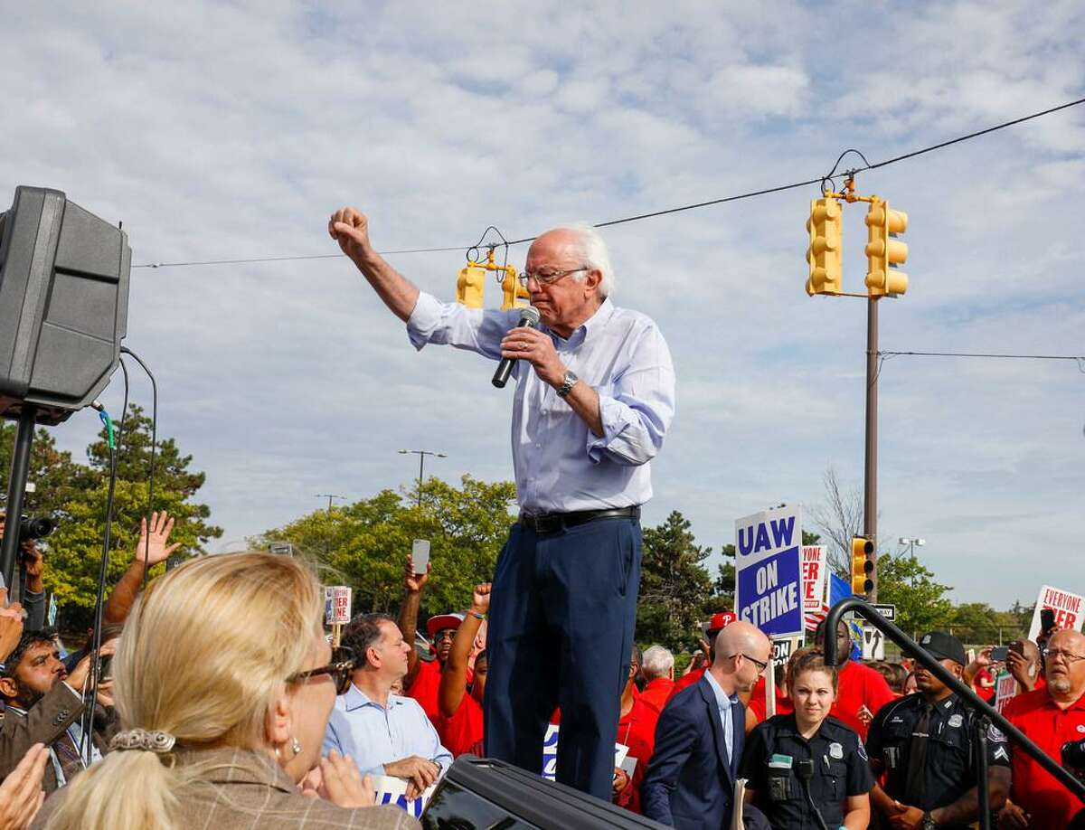 Sen. Bernie Sanders, independent-Vt., visits striking United Auto Workers union members as they picket in Detroit last year.
