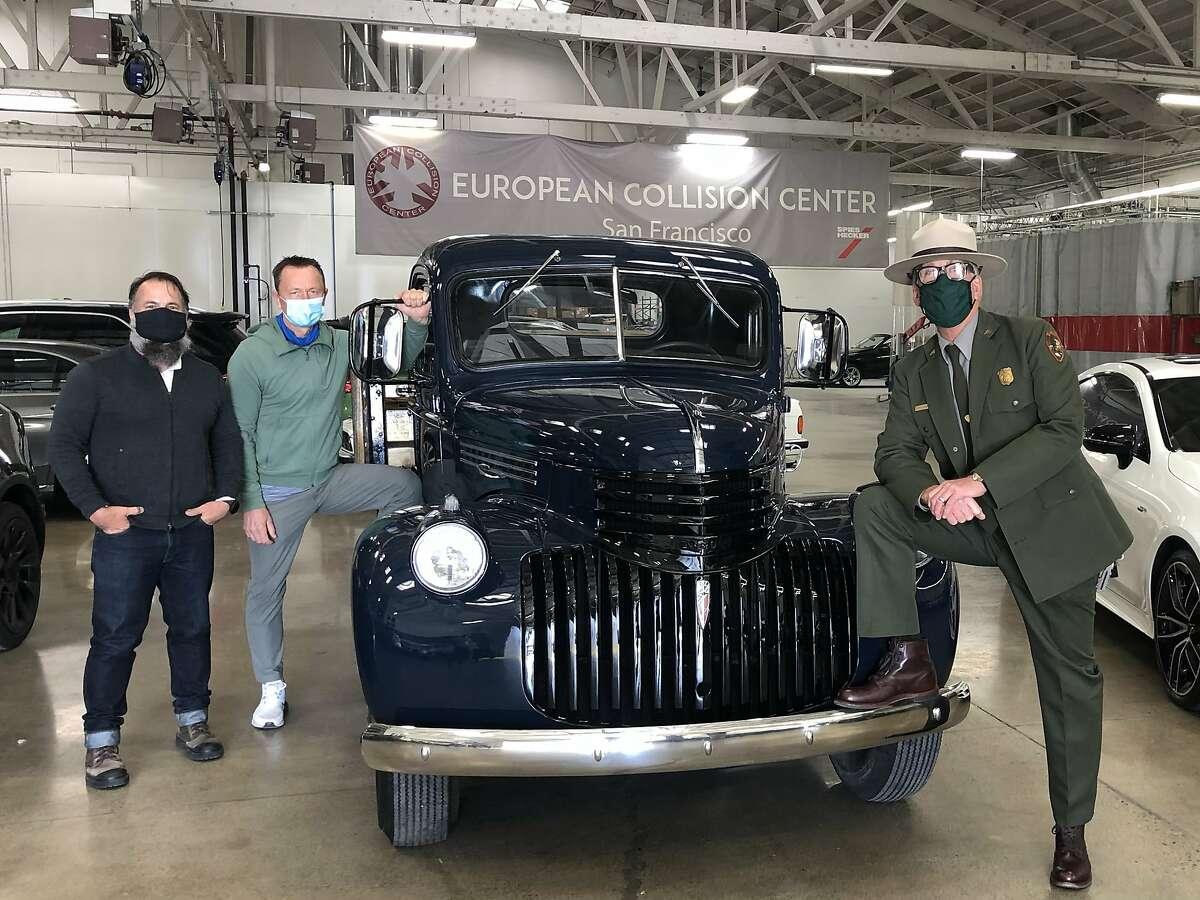 Dennis Kirkpatrick (left) and Ludwik Rutkowski of European Collision Center and Alcatraz ranger John Cantrell show off the 1946 Chevy truck.