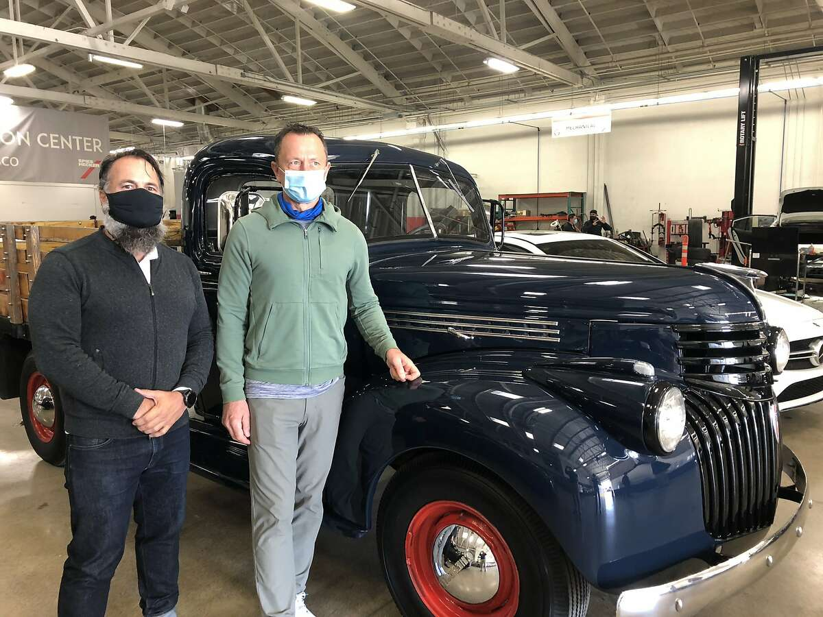 Dennis Kirkpatrick (left) and Ludwik Rutkowski of European Collision Center worked on the three-year restoration project for the 1946 Chevy truck from Alcatraz.