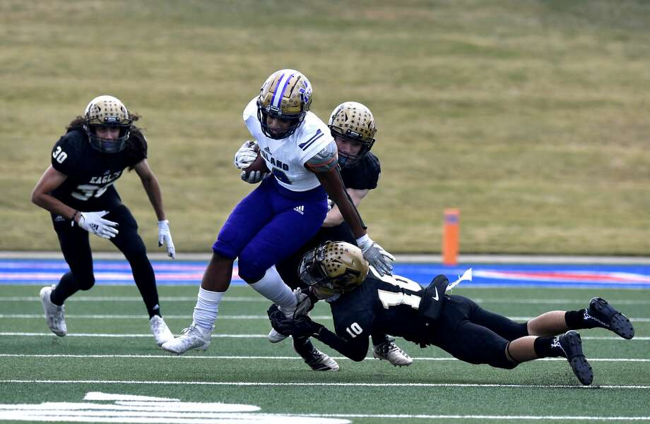 Midland High's Daniel Garcia is tackled by Abilene High's Noah Hatcher during Friday's game at Shotwell Stadium in Abilene Nov. 27, 2020. Photo: Ronald W. Erdrich/Reporter-News / Abilene Reporter-News