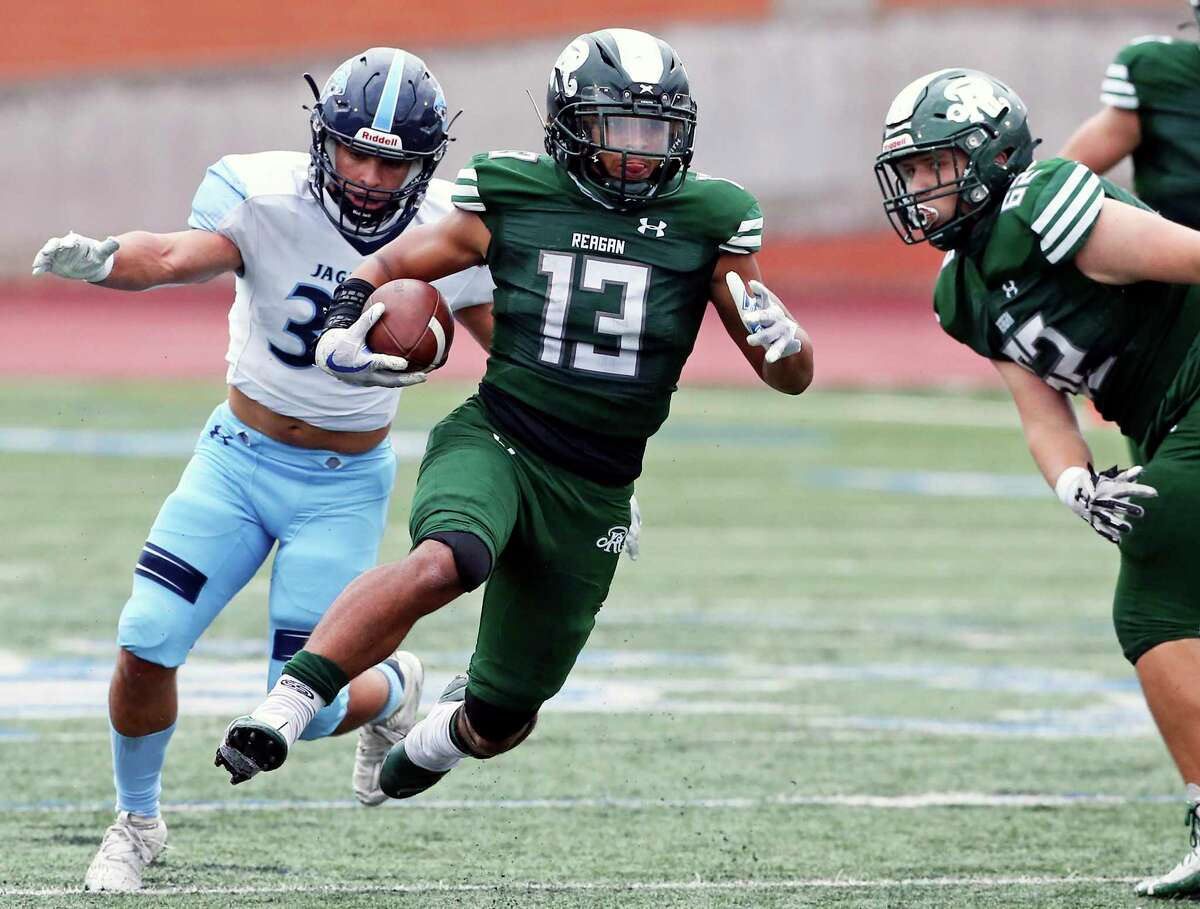 Rattler running back Carson Green bounces away from a tackler for a big gain as Reagan plays Johnson at Heroes Stadium on Nov. 27, 2020.