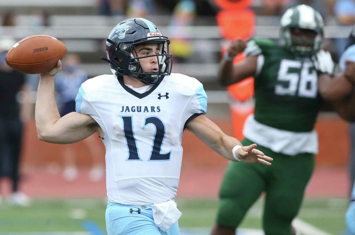Ty Reasoner throws for the Jags as Reagan plays Johnson at Heroes Stadium on Nov. 27, 2020.