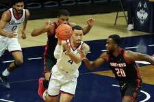 UConn Huskies guard Tyrese Martin (4) moves the ball up court against Hartford Hawks guard Austin Williams (20) in the first half at Harry A. Gampel Pavilion on Friday, Nov. 27, 2020 in Storrs, Connecticut.