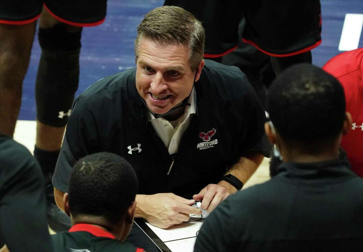 Hartford Hawks coach John Gallagher talks to his players during a timeout against the Connecticut Huskies in the first half at Harry A. Gampel Pavilion on Friday, Nov. 27, 2020 in Storrs, Connecticut.