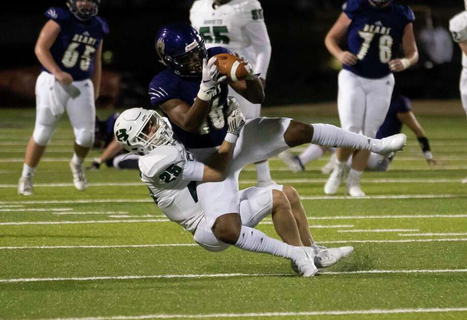 Montgomery halfback Triston Johnson (16) is tackled by Huntsville safety Waylin Zapoli (25) during the second quarter of a District 10-5A (Div. II) football game at Montgomery ISD Stadium, Friday, Nov. 27, 2020, in Montgomery. Photo: Gustavo Huerta, Houston Chronicle / Staff Photographer / 2020 © Houston Chronicle