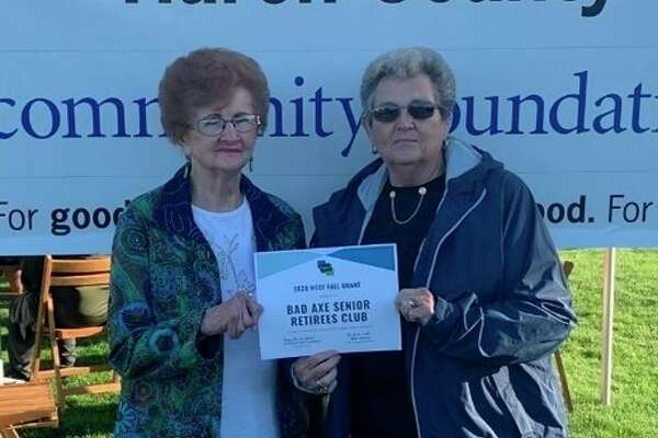 Pictured accepting the grant award is (left) Donna Poppeck, club treasurer, and (right) Mary Gilbert, club secretary. (Submitted Photo)