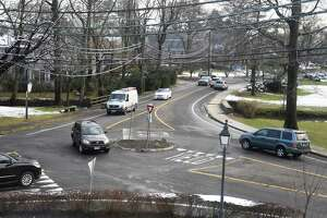 Traffic passes through the roundabout at the intersection of Sound Beach Avenue and Laddins Rock Road bordering Binney Park in Old Greenwich, Conn. Wednesday, Dec. 11, 2019.
