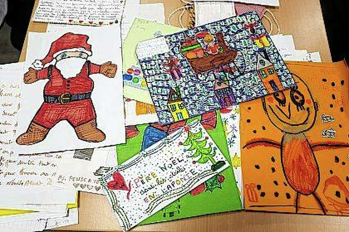 """Mail addressed to """"Pere Noel"""" - Father Christmas in French - is decorated with love hearts, stickers and glitter in Libourne, southwest France."""
