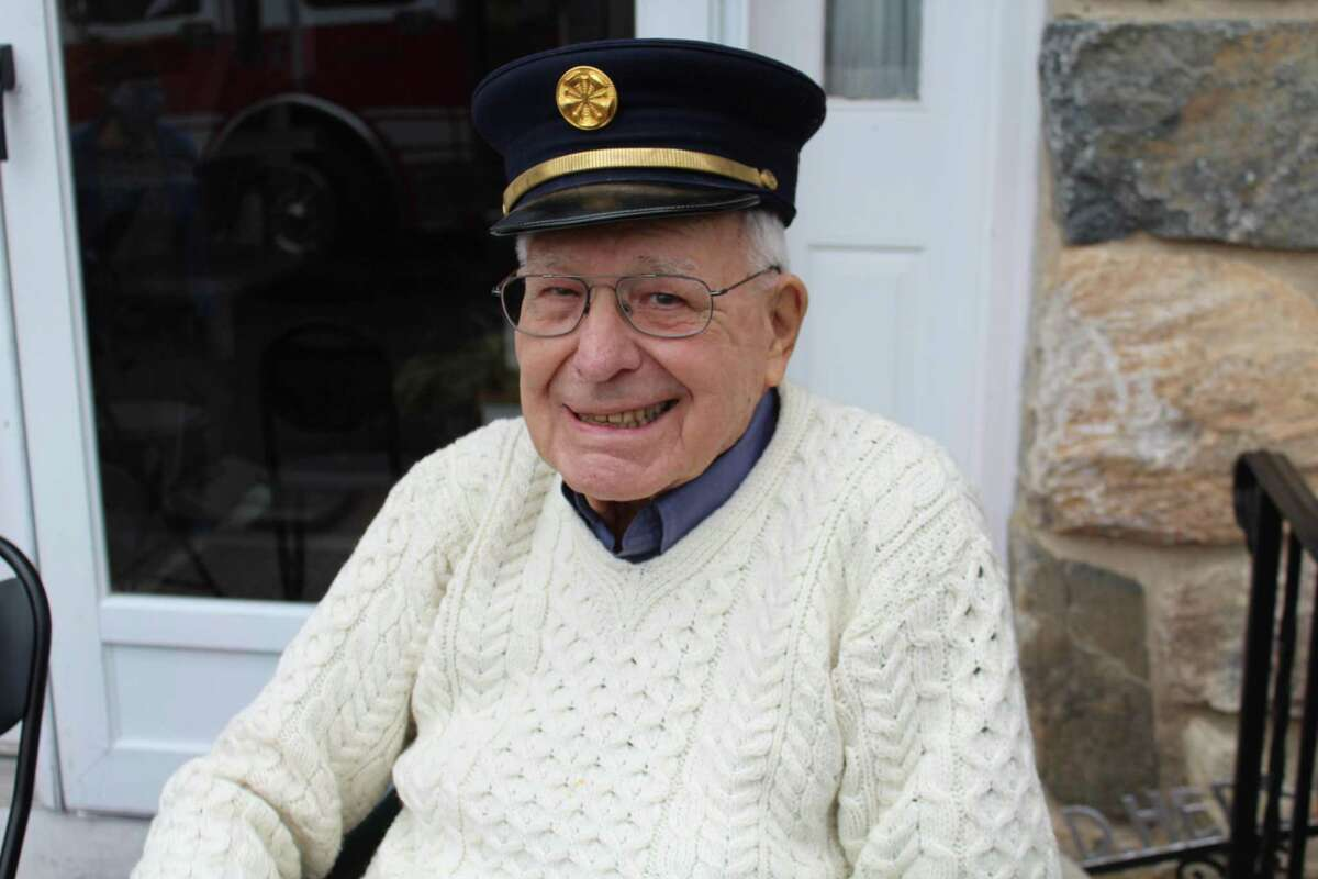 V. Donald Hersam Jr. donned the cap he wore when chief of New Canaan Fire Company No. 1 when firefighters from New Canaan and Vista visited him on his 90th birthday Friday.