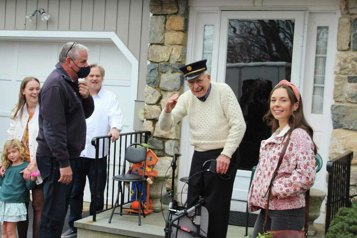 New Canaan Fire Department Capt. Michael Socci greets former Fire Chief and Advertiser publisher V. Donald Hersam Jr. on Hersam's 90th birthday Friday, Nov. 27. The Fire Department took two trucks, accompanied by one from Vista, N.Y., to visit Hersam at his Graystone Circle home.