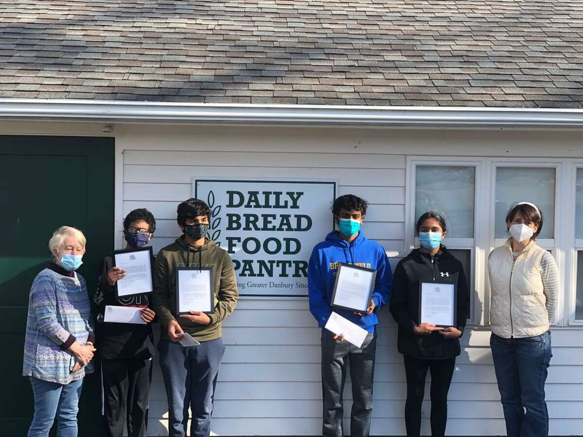 A group of students devoted multiple weekends this fall to raking leaves and cleaning up yards to raise money for Danbury's Daily Bread Food Pantry.