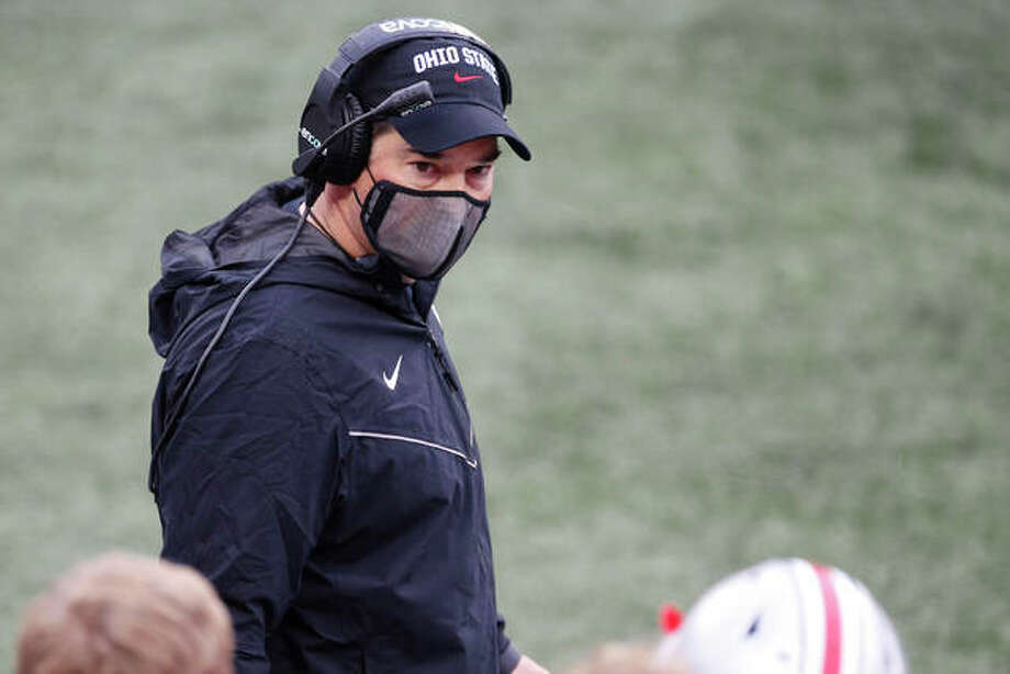 Ohio State coach Ryan Day talks to his players during a Big Ten Conference college football game against Indiana on Nov. 21 in Columbus, Ohio. A rise in positive COVID-19 tests forced the Buckeyes to cancel their game Saturday at Illinois. Photo: Associated Press