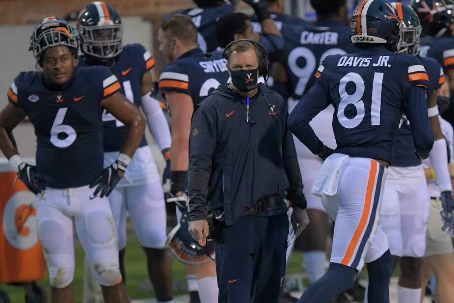 Virginia Head Coach Bronco Mendenhall and his team made it to Tallahassee only to find out their game against Florida State was postponed. They are shown Nov. 21, 2020, during a game between the University of Virginia Cavaliers and Abilene Christian Wildcats at Scott Stadium in Charlottesville, Va. Photo: Washington Post Photo By John McDonnell / The Washington Post