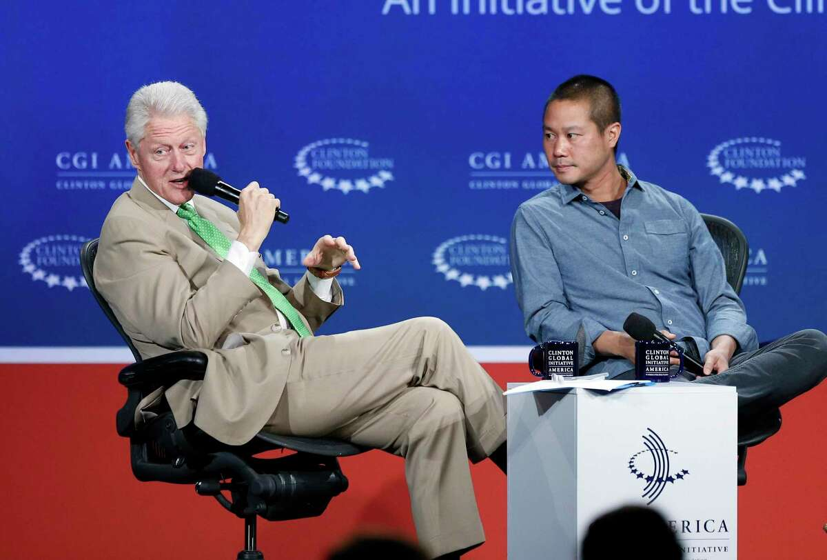 In this June 25, 2014, file photo, former President Bill Clinton, left, speaks with Zappos.com CEO Tony Hsieh during a forum on the final day of the annual gathering of the Clinton Global Initiative America in Denver. Hsieh, retired CEO Zappos.com, has died. Hsieh was with family when he died Friday, Nov. 27, 2020, according to a statement from DTP Companies, which he founded. Downtown Partnership spokesperson Megan Fazio says Hsieh passed away in Connecticut after a house fire in New London. Hsieh recently retired from Zappos after 20 years leading the company. He worked to revitalize the Las Vegas area.